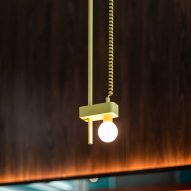 Lambert & Fils pendant lights are suspended from yellow telephone wire above the seating area