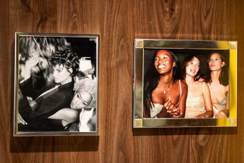 Framed photographs of iconic 90s fashion models