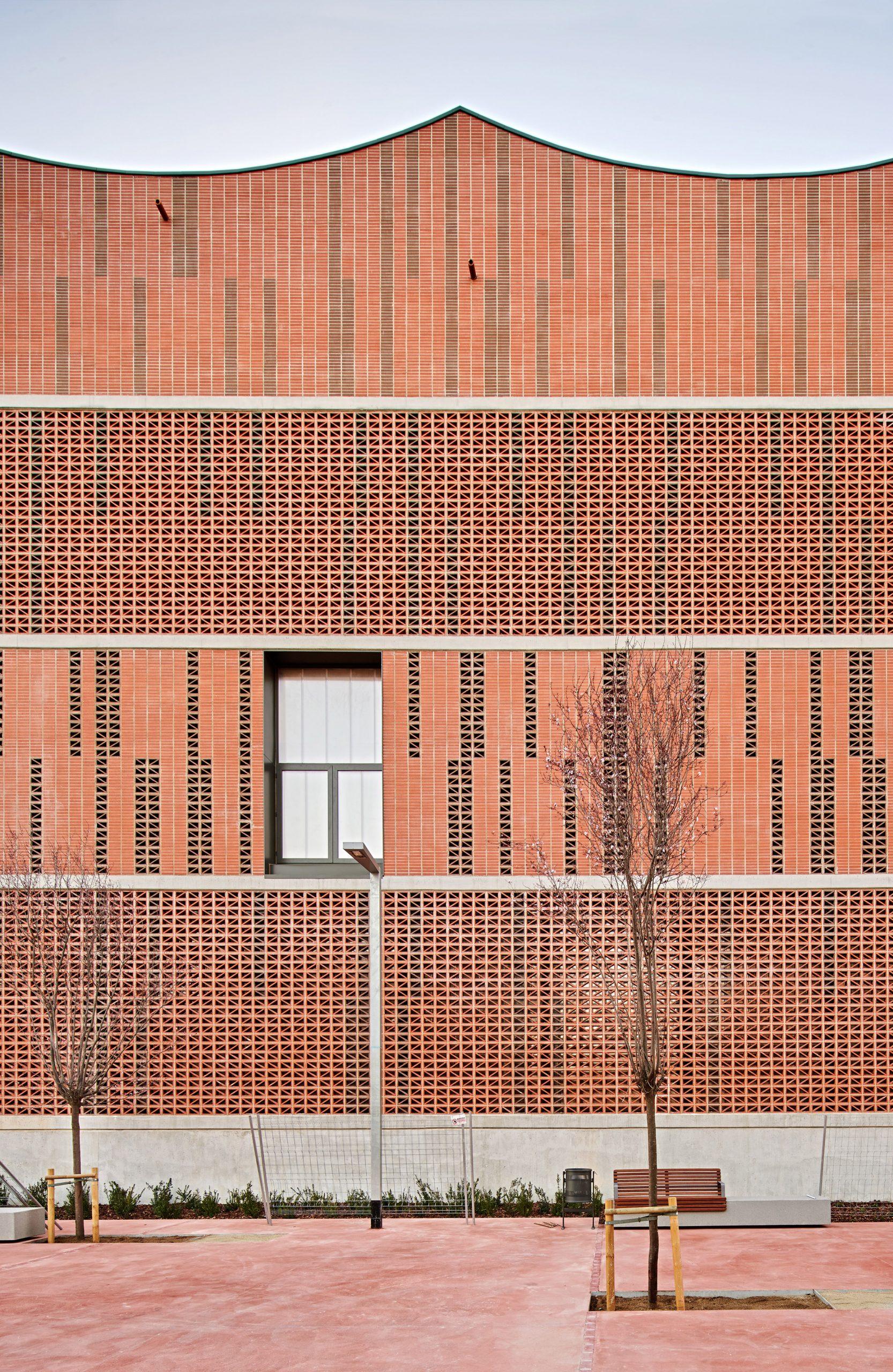 Brick facade of Camp del Ferro sports centre in Barcelona