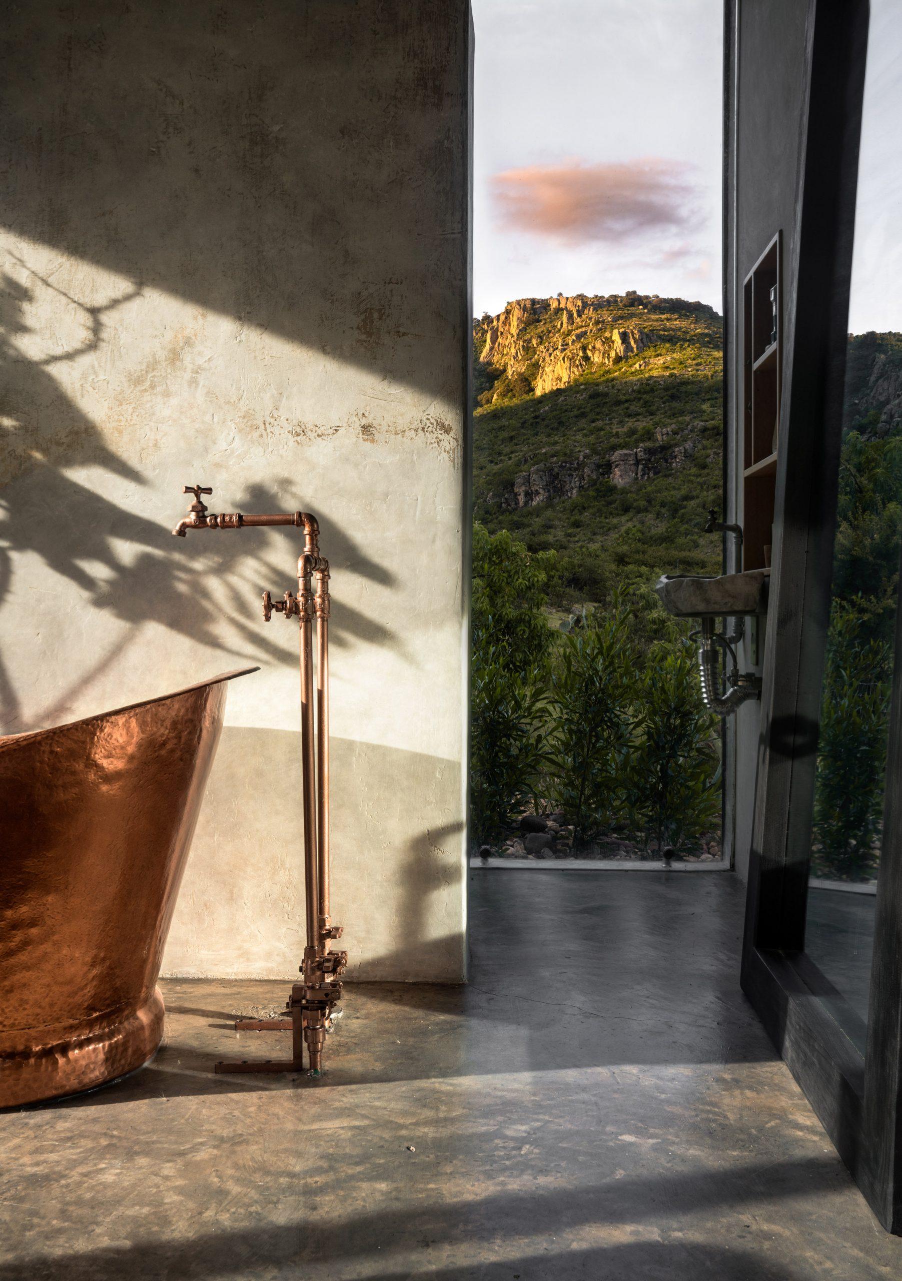 Bathroom and copper tub of Casa Eterea cabin by Prashant Ashoka