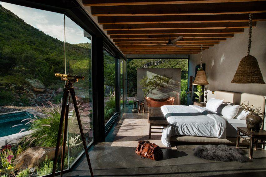 Bedroom of mirrored cabin designed by Prashant Ashoka