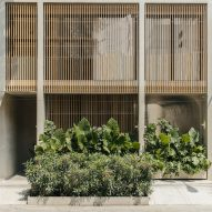 Wooden lattices screen concrete hotel by PPAA in Mexico City