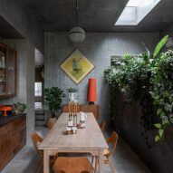A dining area inside Concrete House by RAW Architecture Workshop in East Sussex