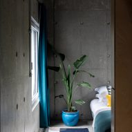 A bedroom of Concrete House by RAW Architecture Workshop in East Sussex