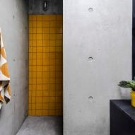 A bathroom in Concrete House by RAW Architecture Workshop in East Sussex