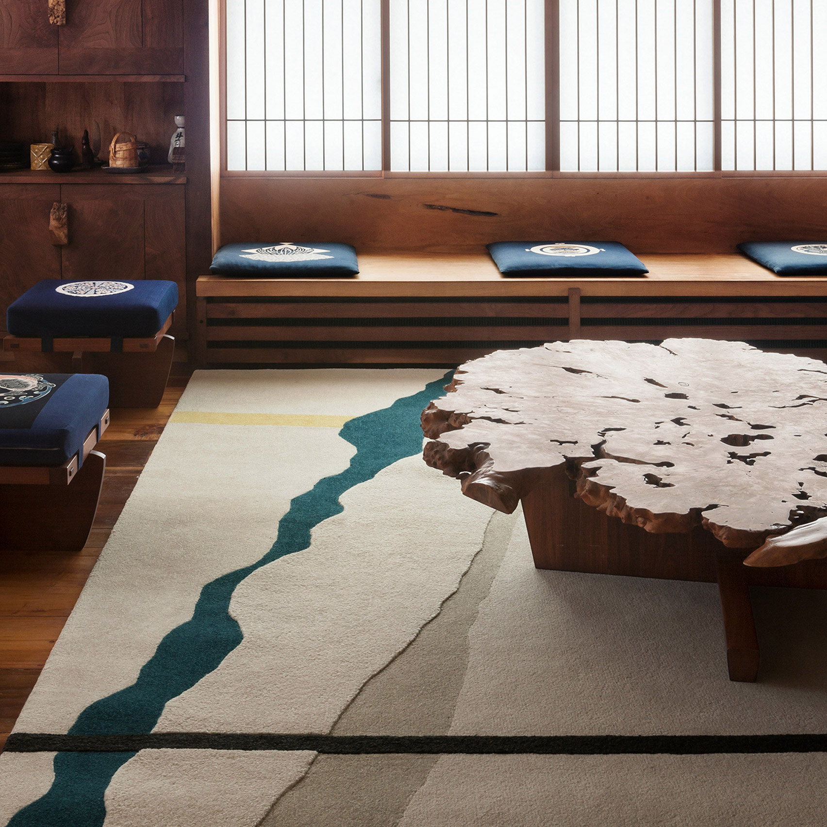 A room featuring the Conoid II rug by George Nakashima for Tai Ping Carpets