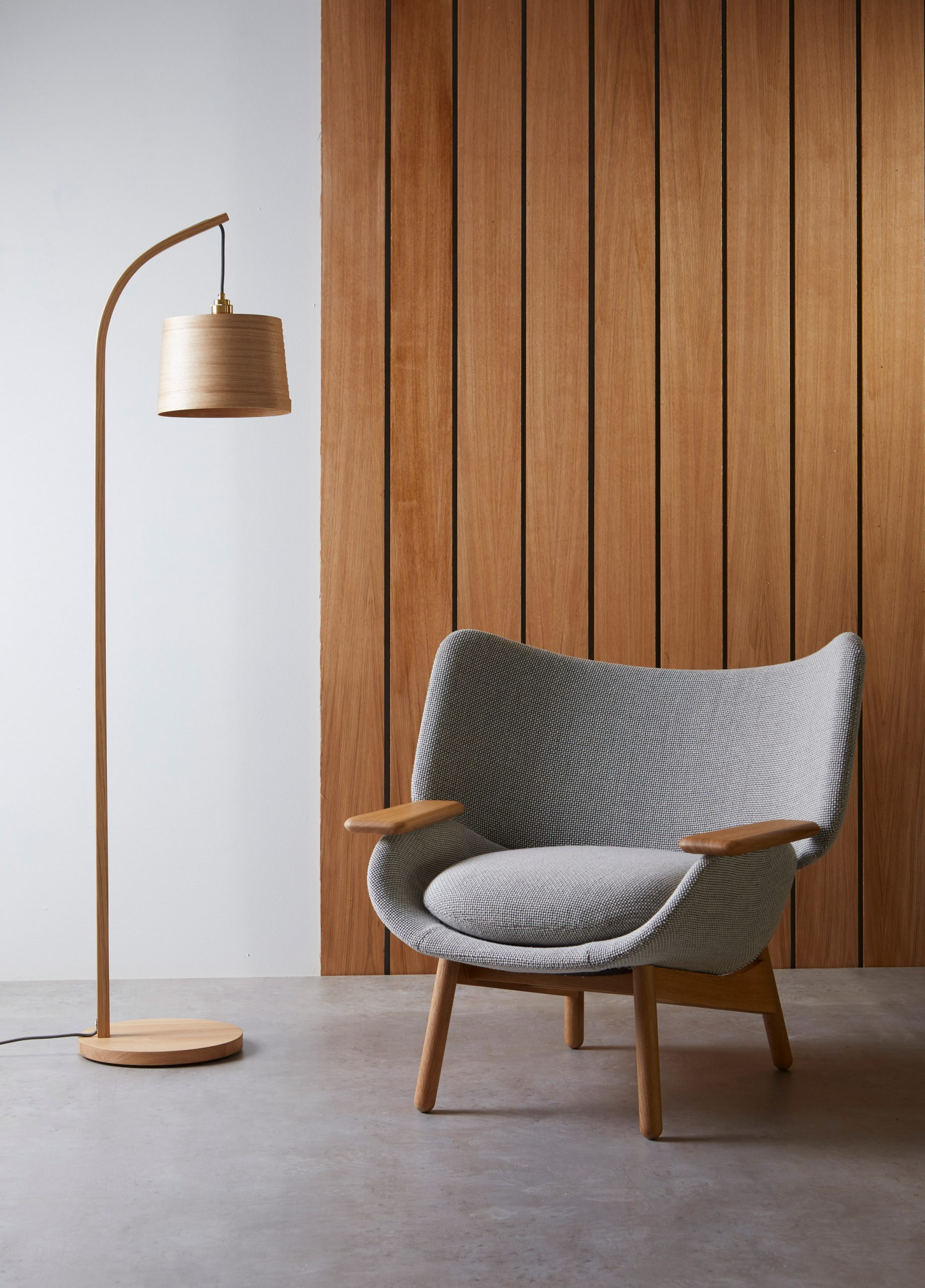 A chair upholstered with Camira Flax fabric by Camira