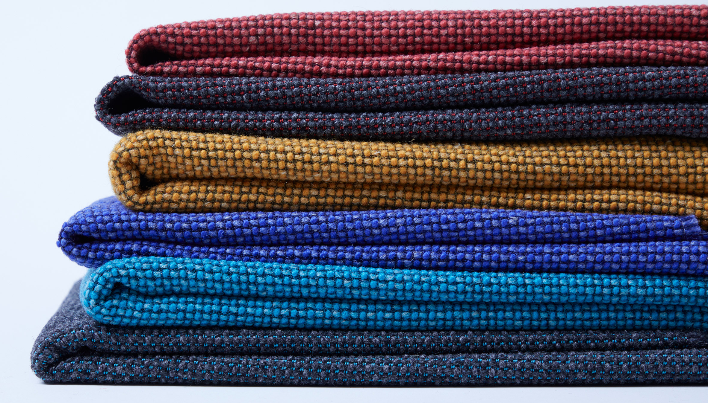 Six styles of the Camira Flax fabric by Camira