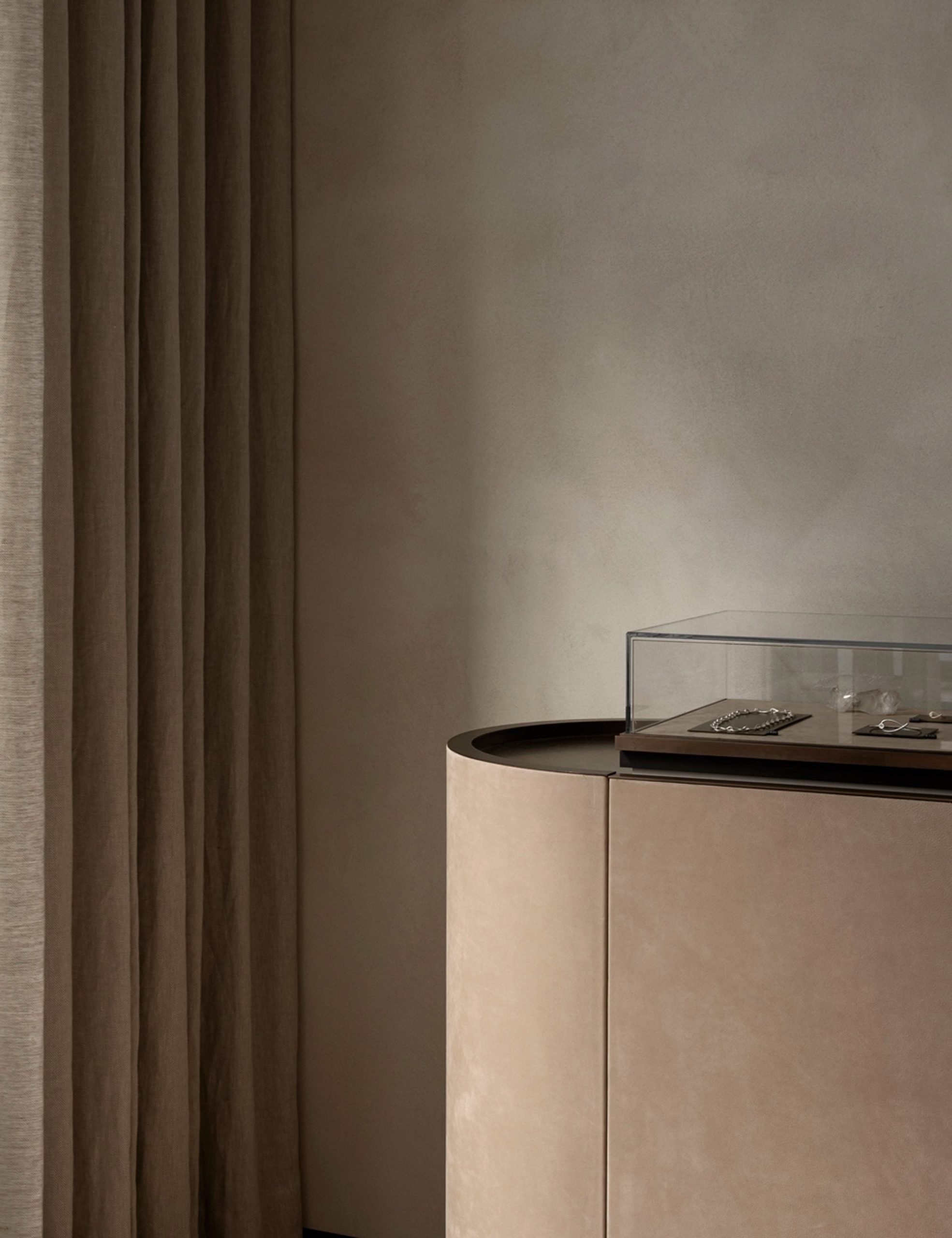 Curtains and suede display case in retail interior by Norm Architects