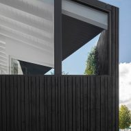 The stained-wood exterior of the floating house by i29