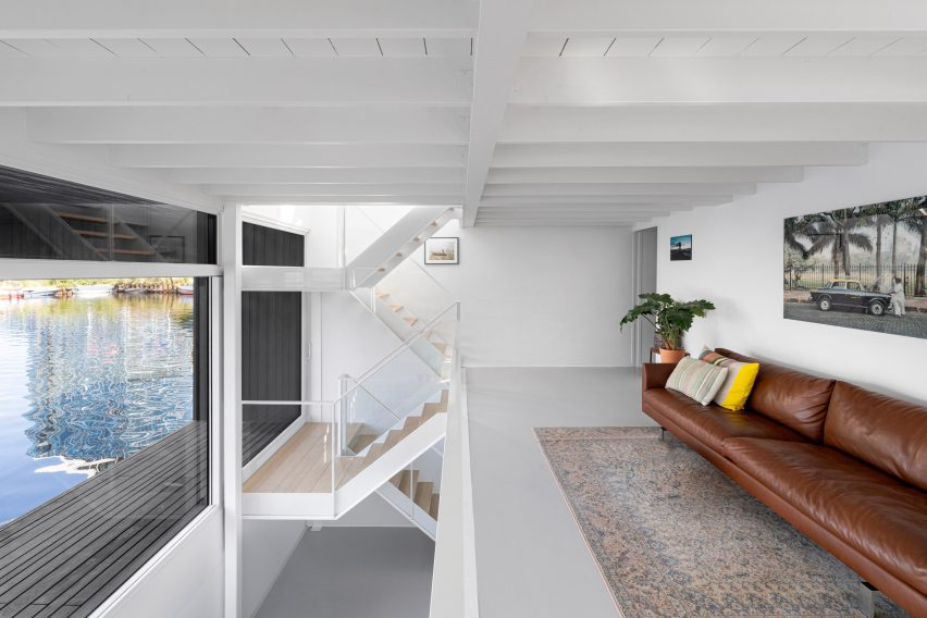 The white interiors of the floating house by i29