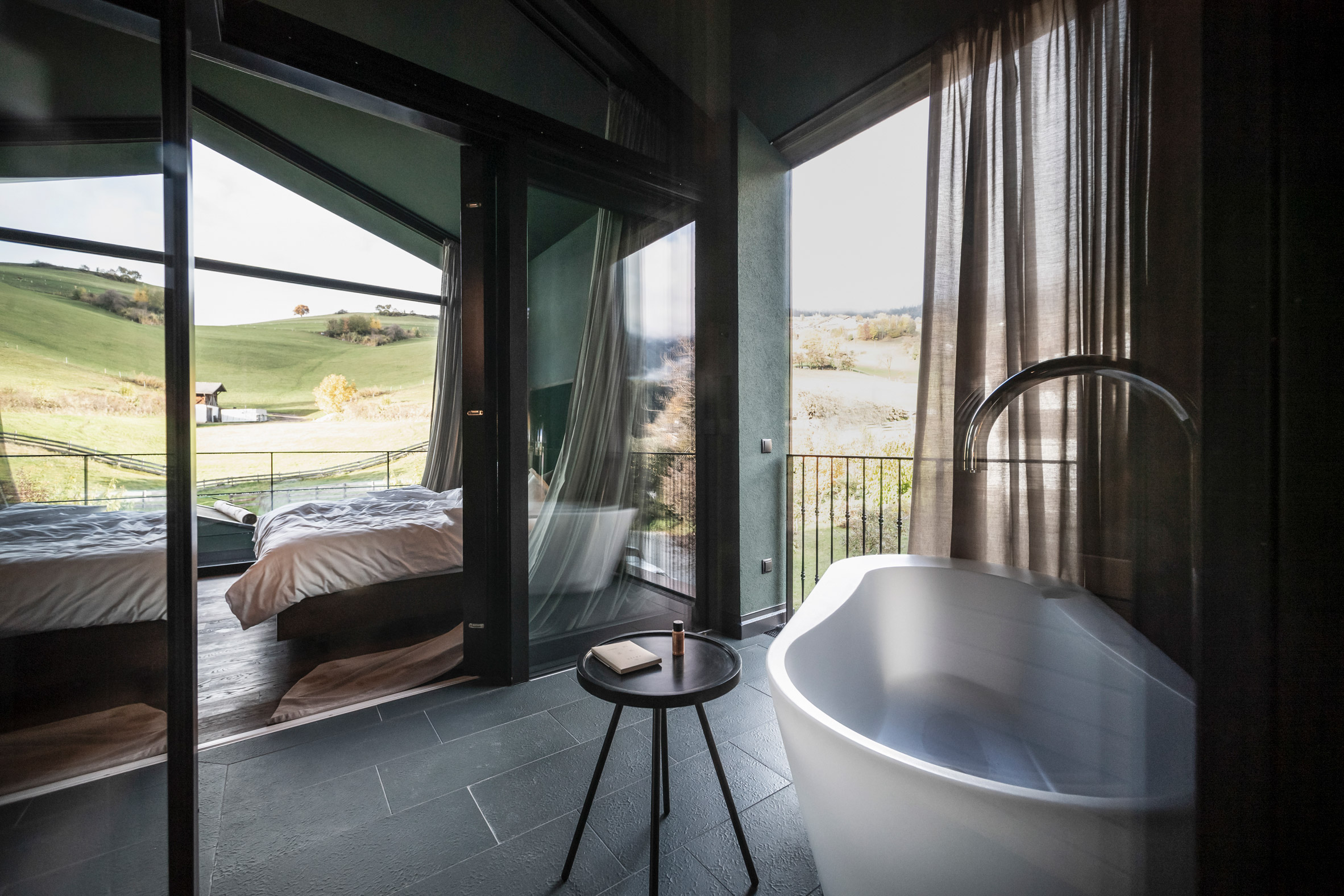 A bathroom and sauna in the Floris hotel extension by NOA