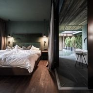 A bedroom inside the Floris hotel extension by NOA