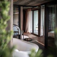 A bathroom inside the Floris hotel extension by NOA