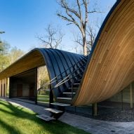 Partisans tops rebuilt pool house in Ontario with undulating timber roof