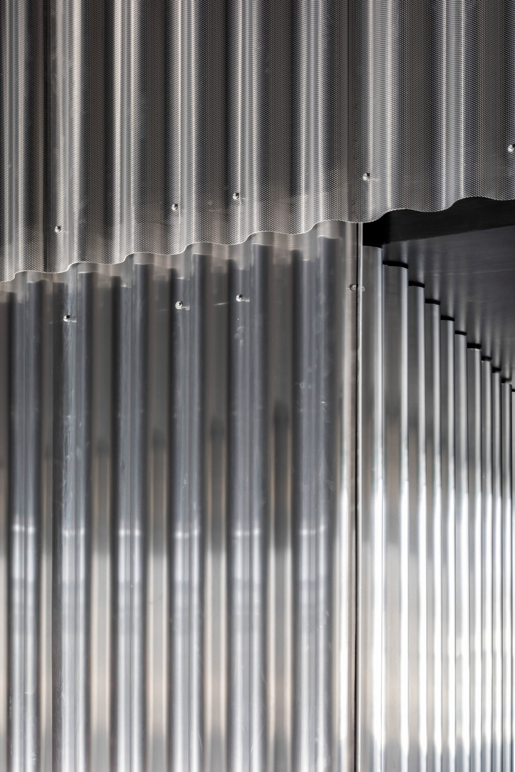 Corrugated aluminium-clad walls