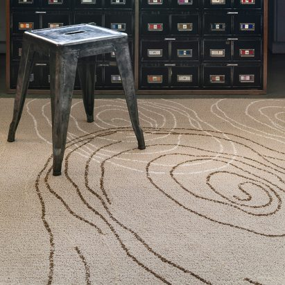 A room featuring the Heavenly Star I rug by Raymond Loewy for Tai Ping Carpets