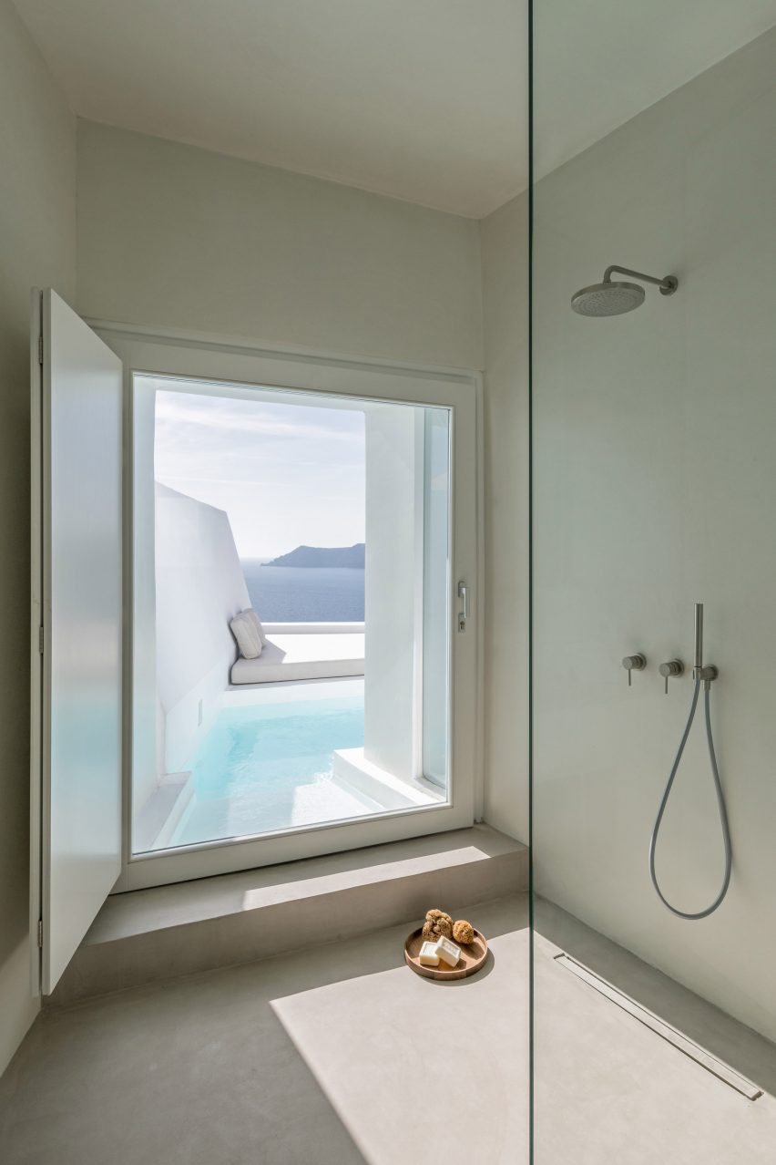 Minimalist hotel bathroom with view of the sea