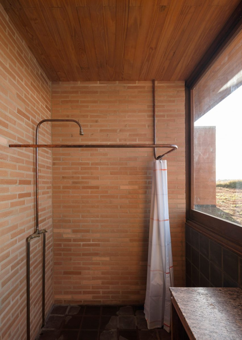 Brick-clad shower room with countryside view