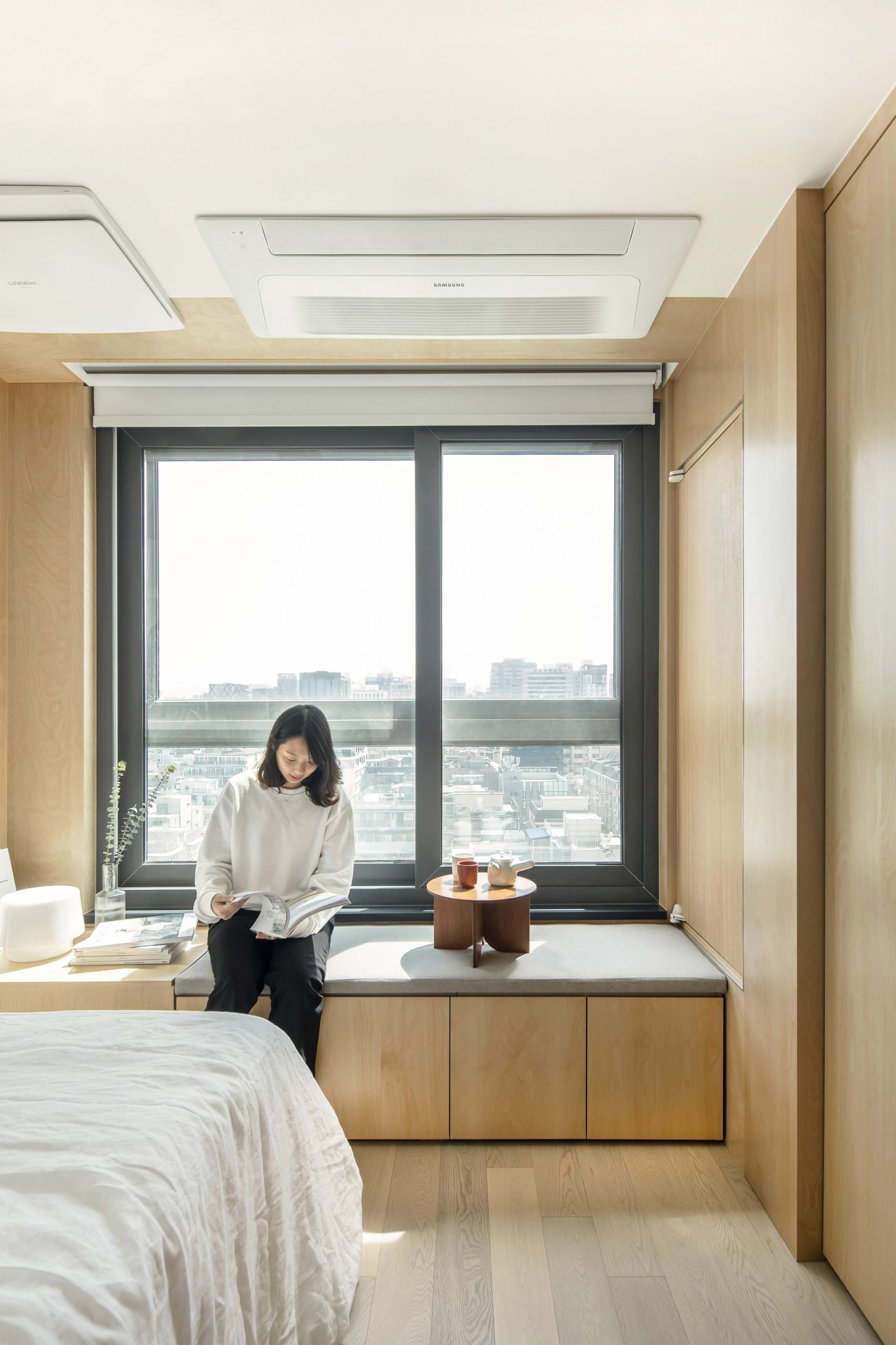 A window seat inside a LIFE micro-apartment by Ian Lee