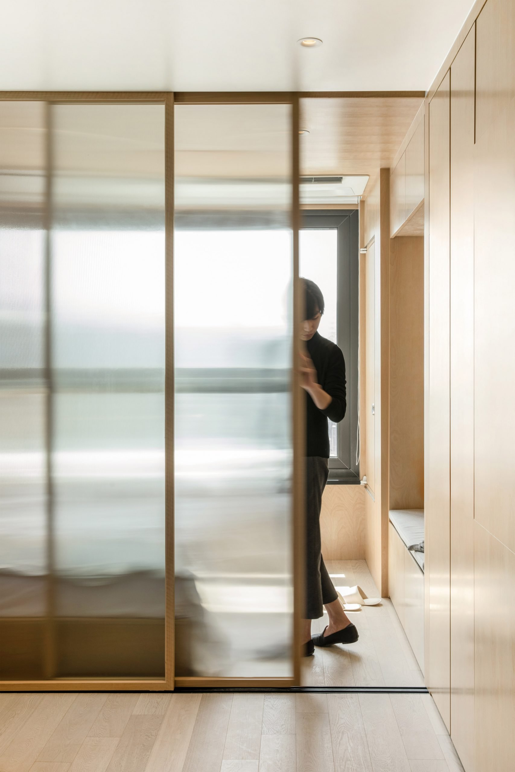 A sliding partition inside a LIFE micro-apartment by Ian Lee