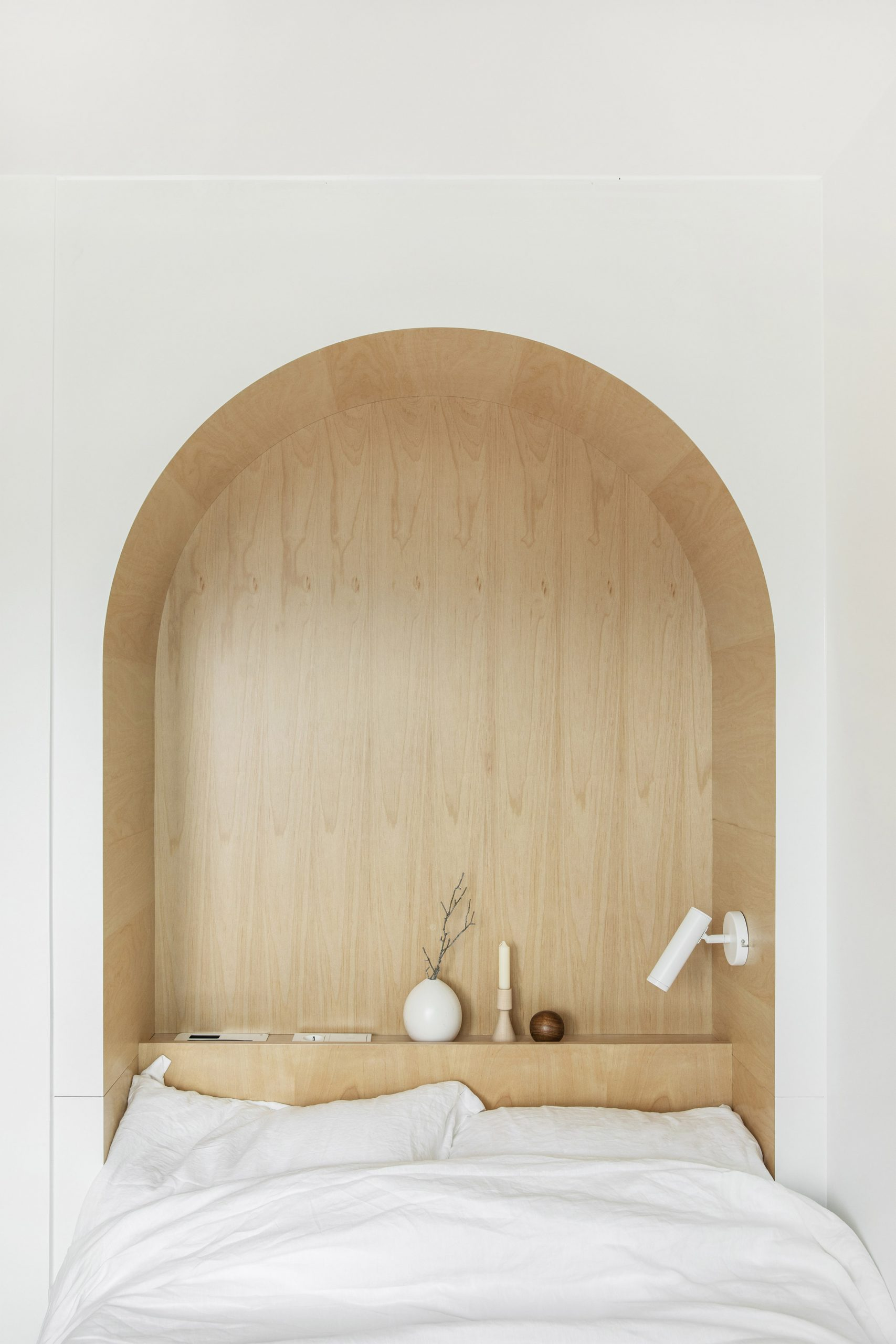An arched cut-out inside a LIFE micro-apartment by Ian Lee