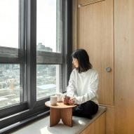 A window seat in a LIFE micro-apartment by Ian Lee
