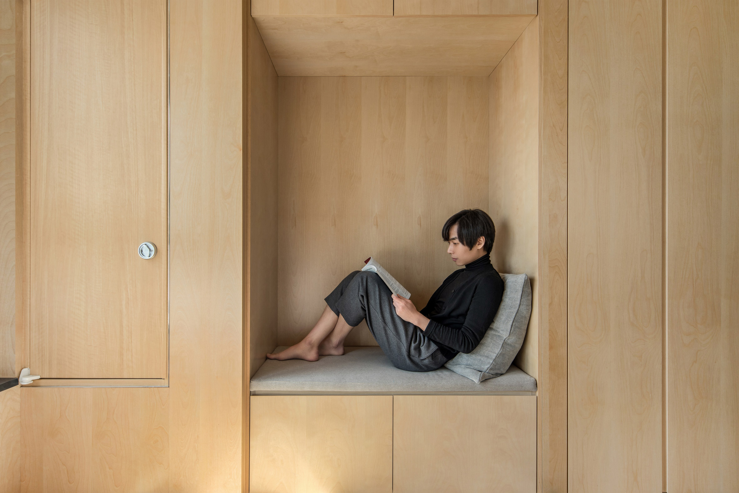 A reading nook inside a LIFE micro-apartment by Ian Lee