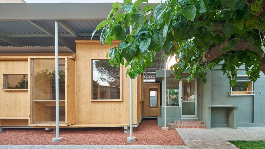 Cross-laminated timber new build next to original brick home