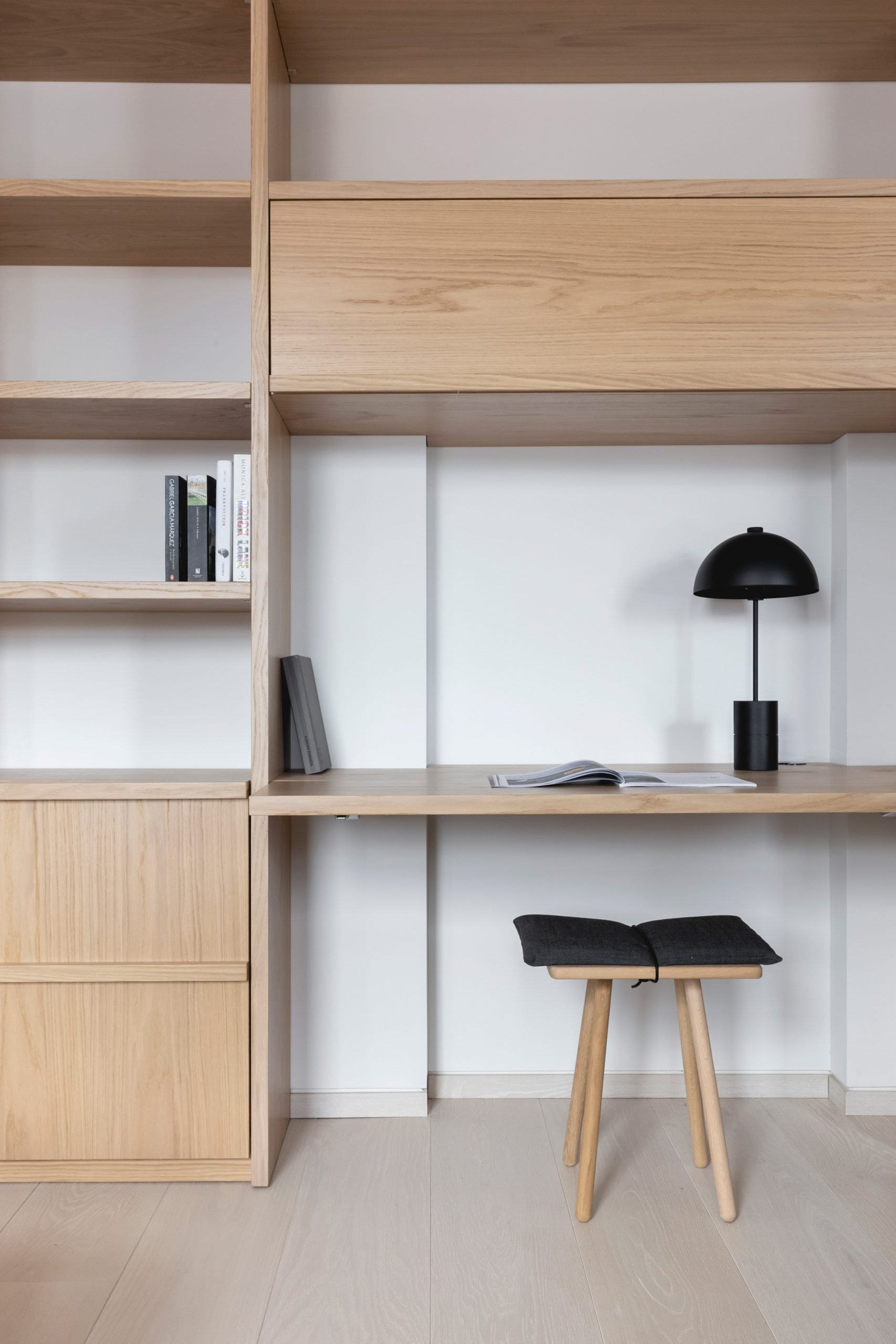 Built-in wooden storage in Mayfair pied-à-terre interior by MWAI
