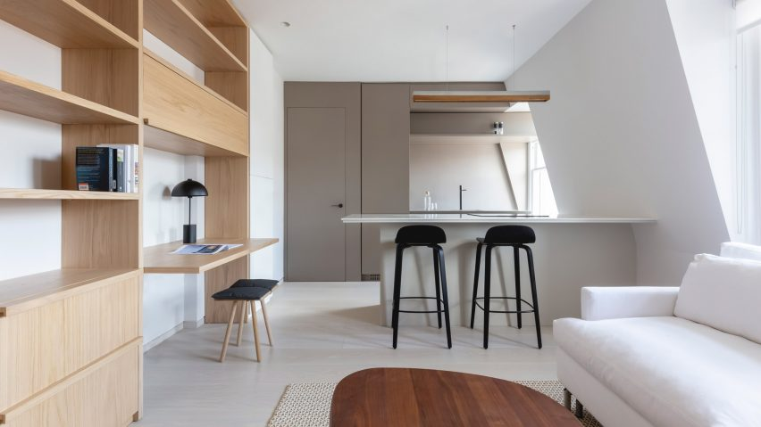 Kitchen and built-in shelves in pied-à-terre interior by Mwai