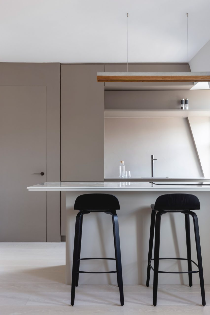 Open kitchen with bar stools in a London apartment