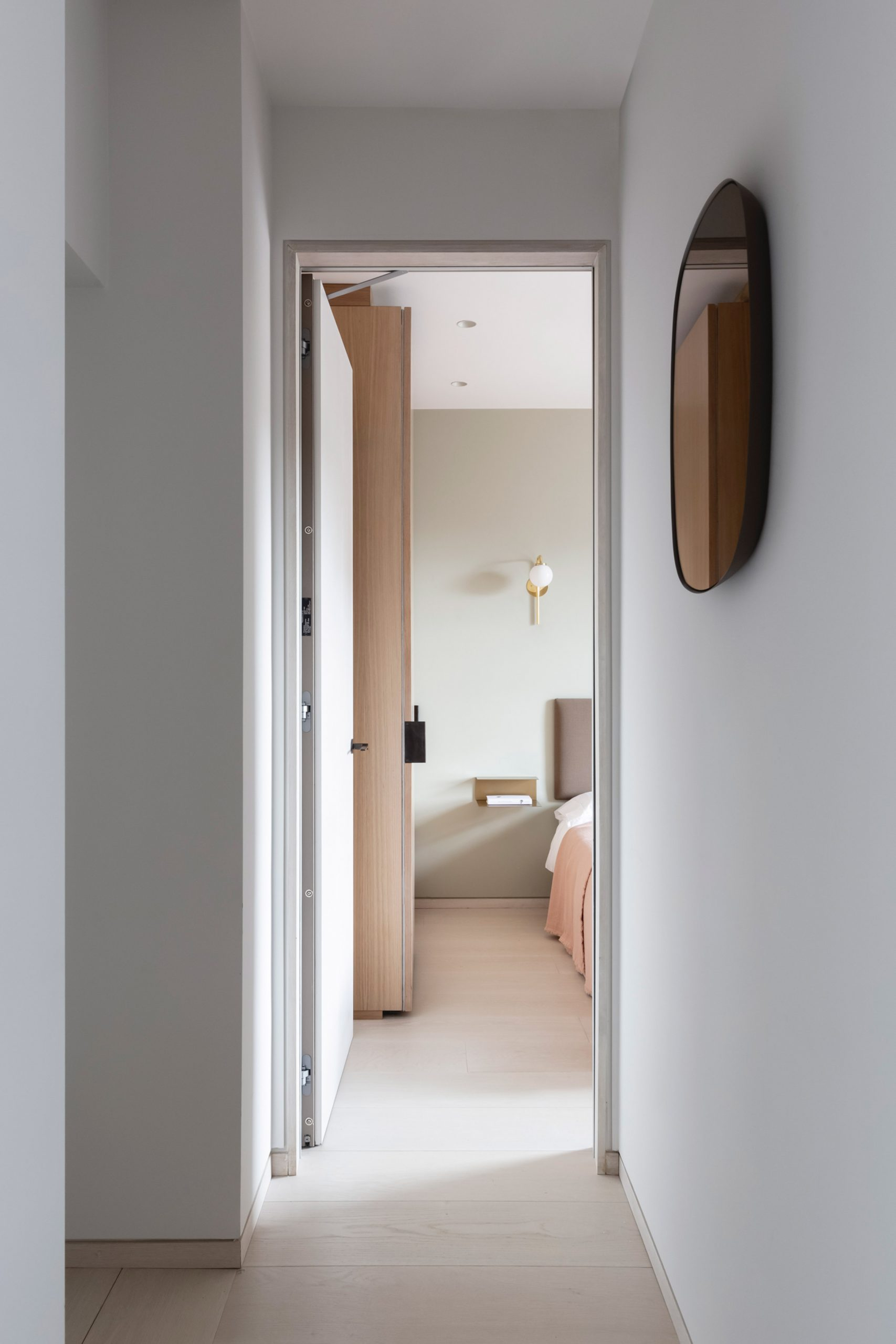 Hallway view into bedroom of Mayfair pied-à-terre by MWAI