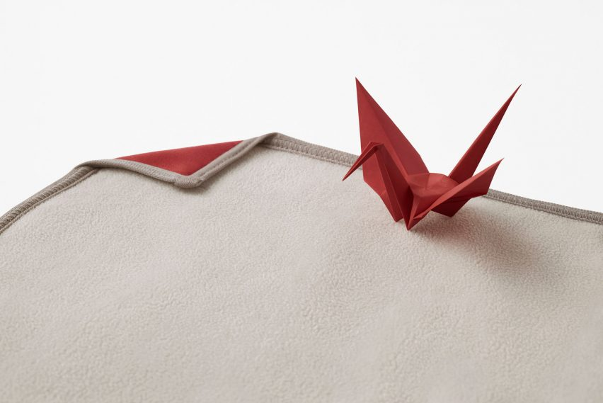 Red origami crane and blanket by Nendo for Japan Airlines