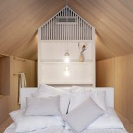 The sleeping area inside the Niliaitta cabin by Studio Puisto