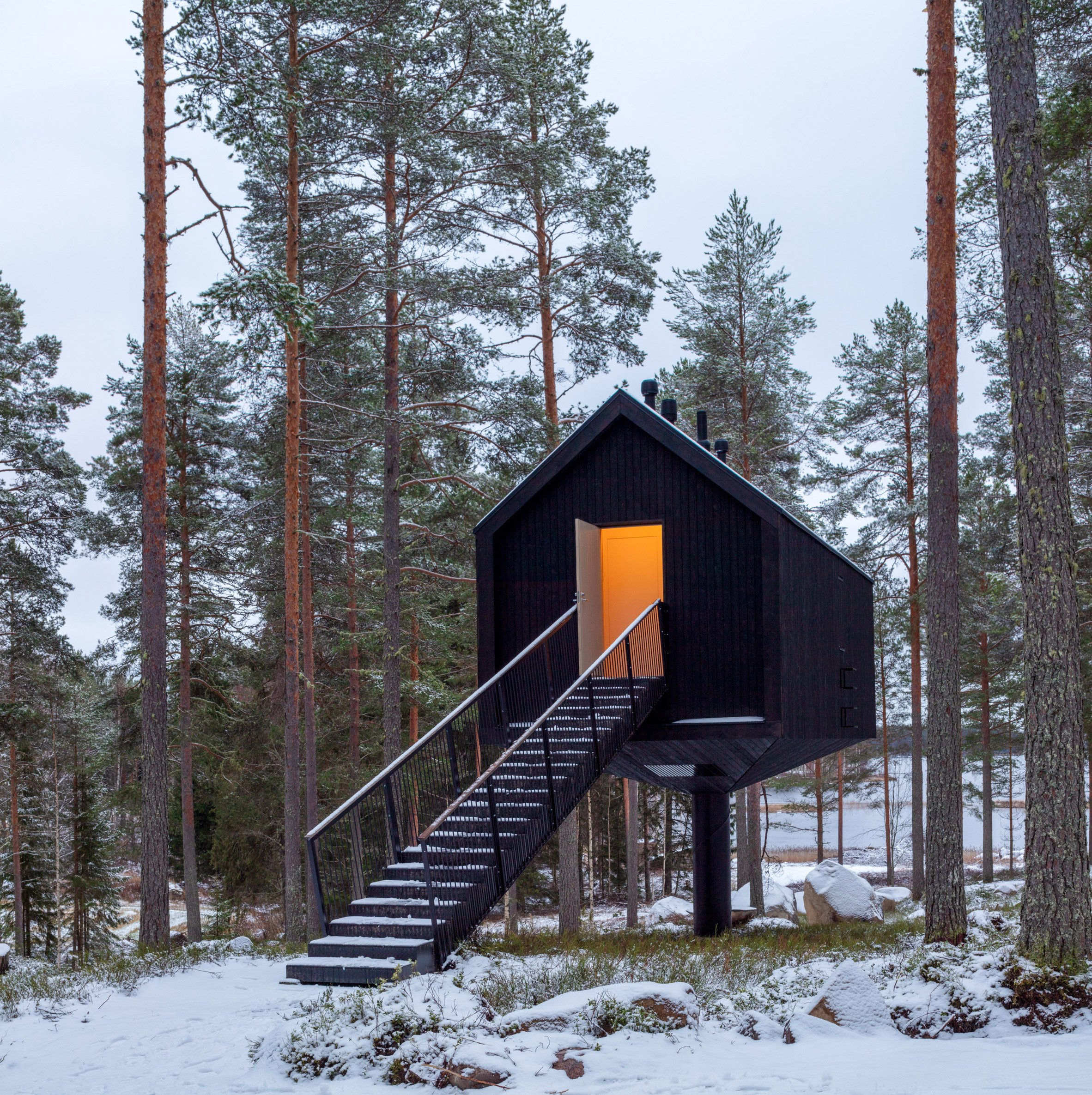 A Finnish cabin clad in black-painted wood