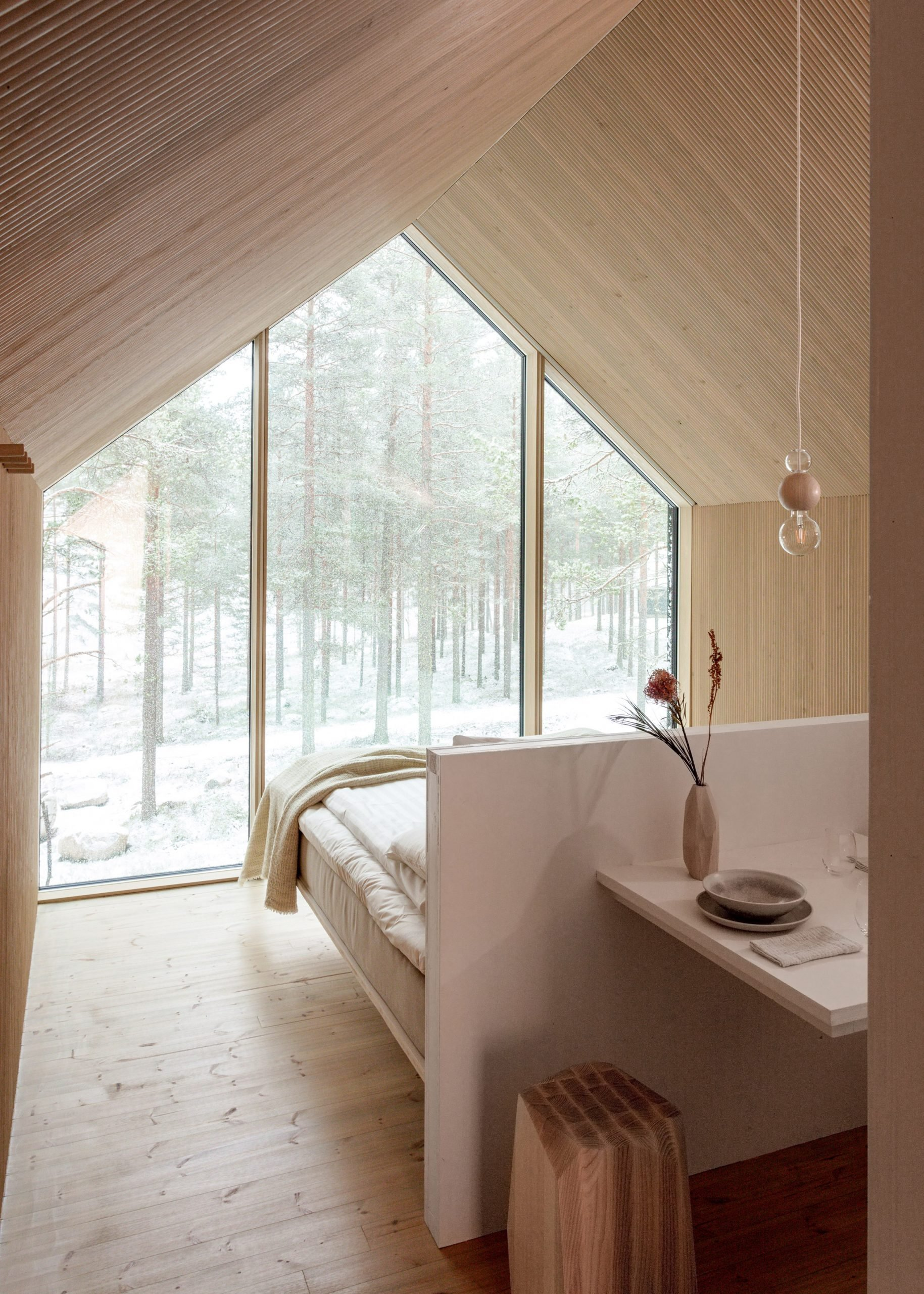 The light-wood interiors of a woodland cabin in Finland