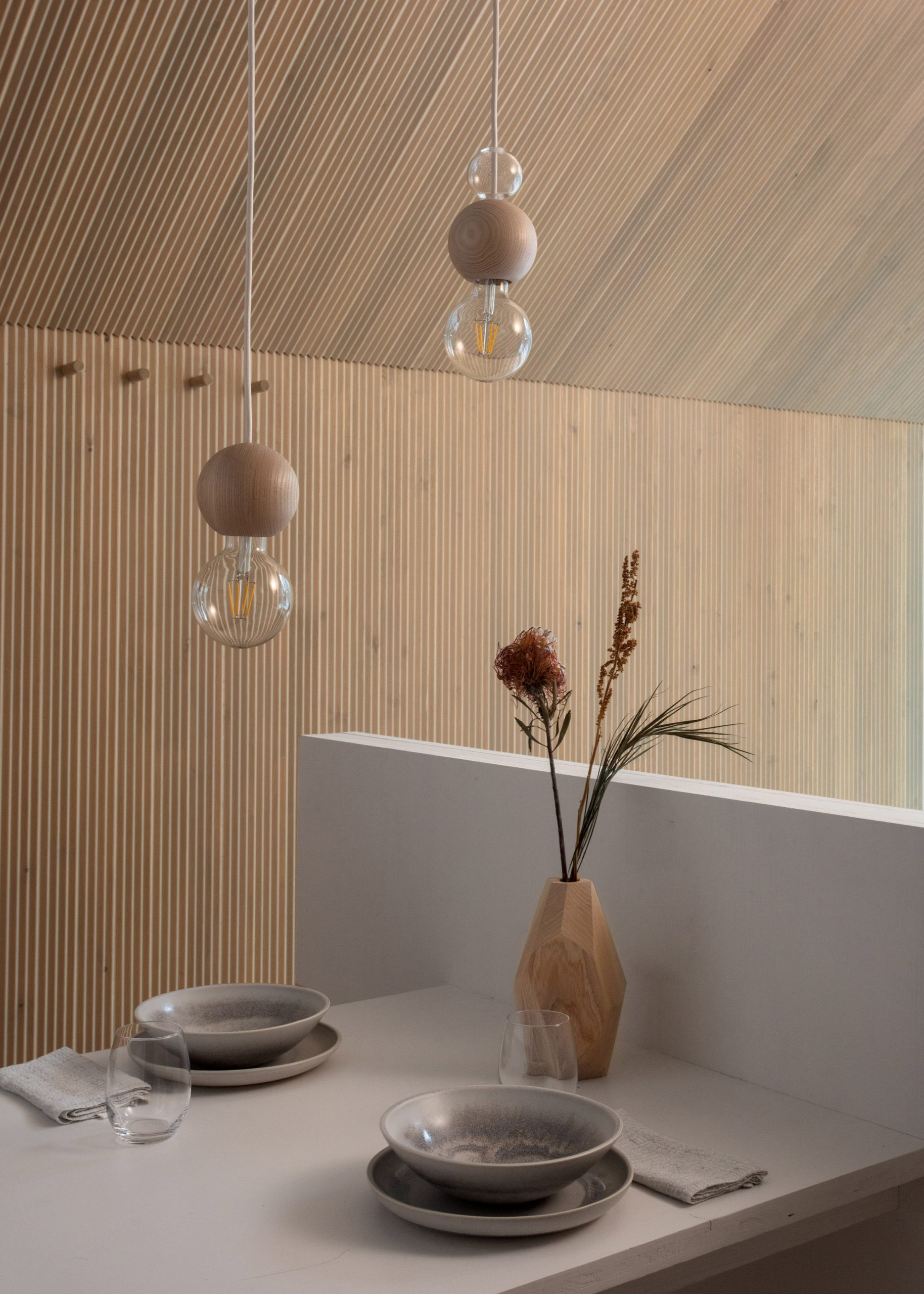 The light-wood interiors of a woodland cabin