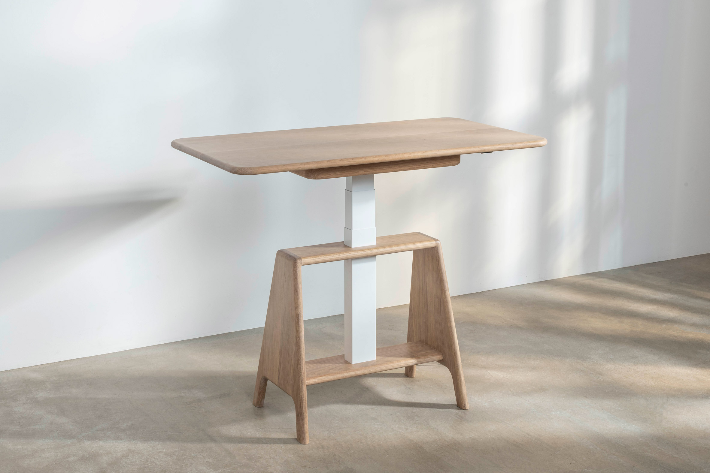 A Noa sit-stand desk by Benchmark with at standing height