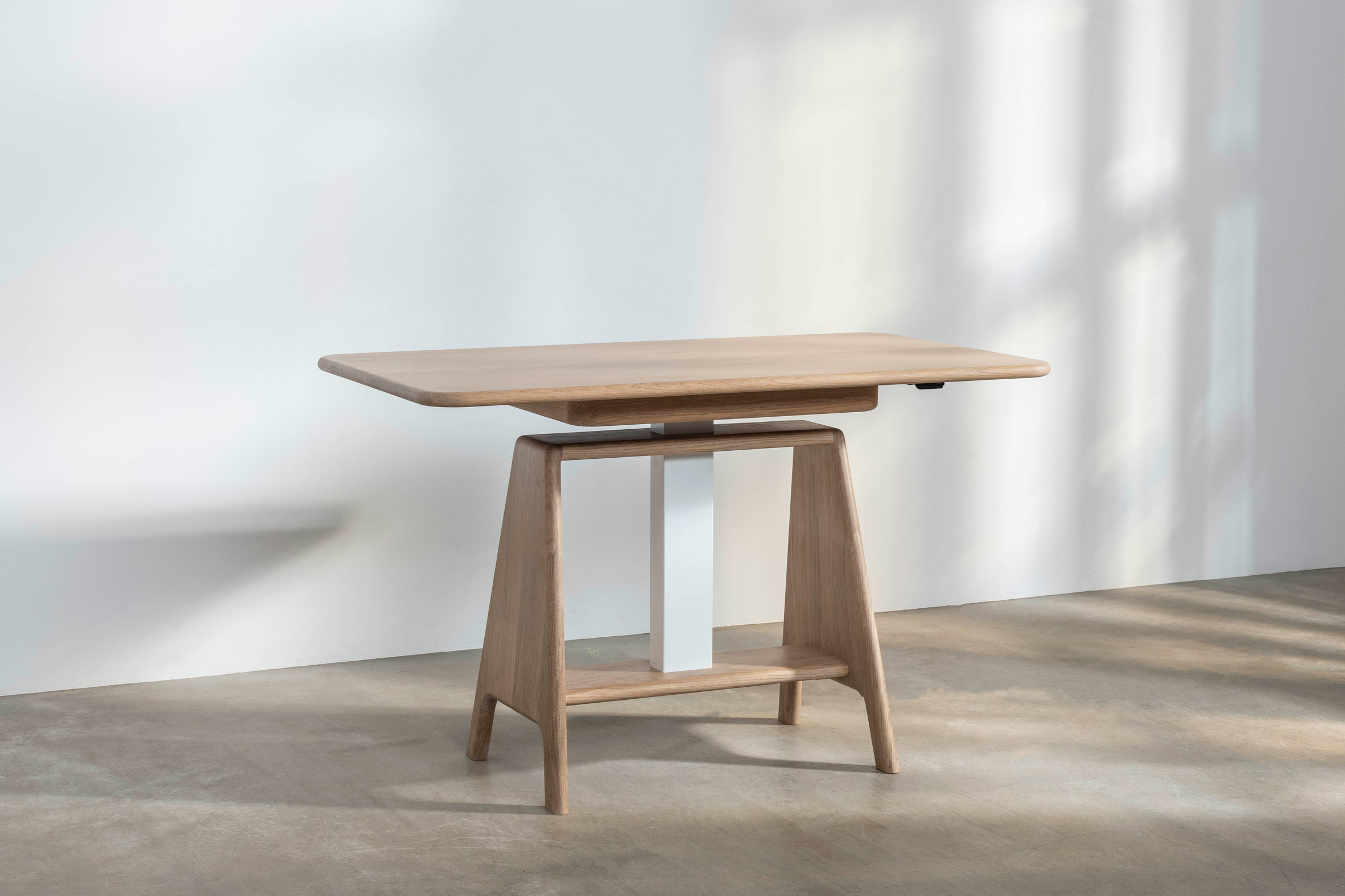 A Noa sit-stand desk by Benchmark with at sitting height