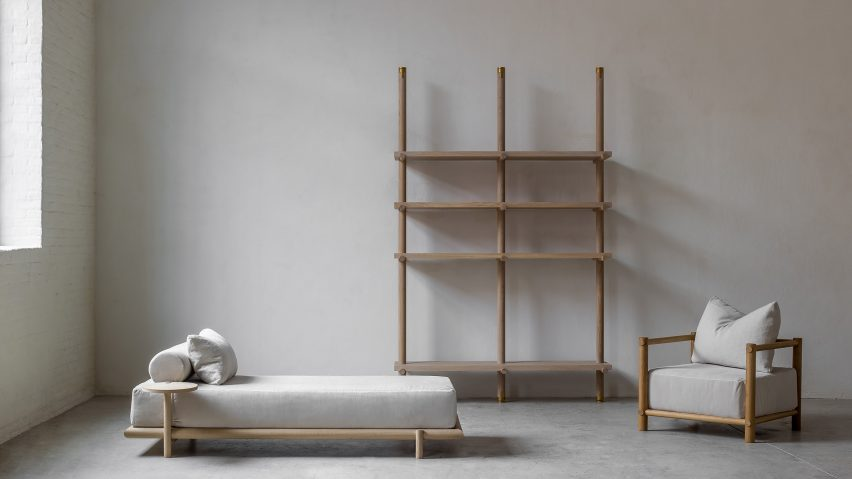 Oak daybed, library and armchair in Nomad furniture by Nathalie Deboel