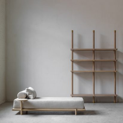 Daybed, library and armchair in Nomad furniture by Nathalie Deboel