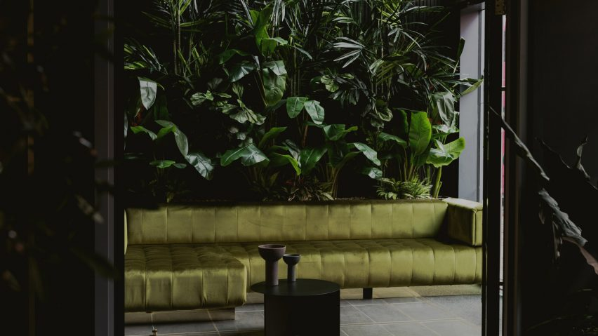 Green walls and sofa in the Urban HQ office by Kingston Lafferty Design