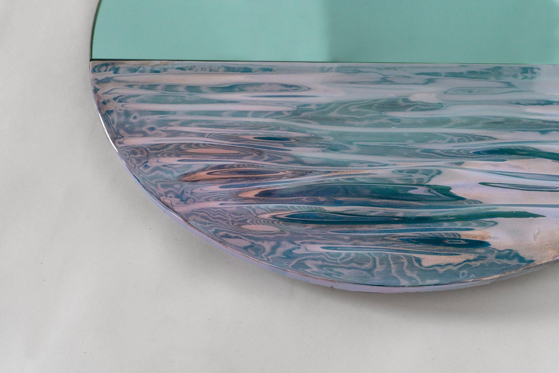 Close-up of Orizon mirror by Ocrum Studio in vivid blue