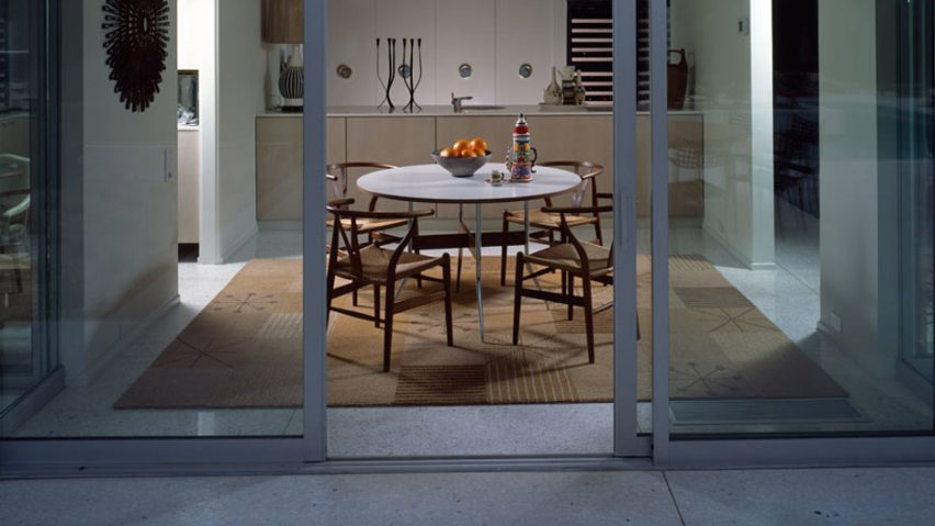 A dining room with the Picnic Blanket I rug by Raymond Loewe for Tai Ping Carpets