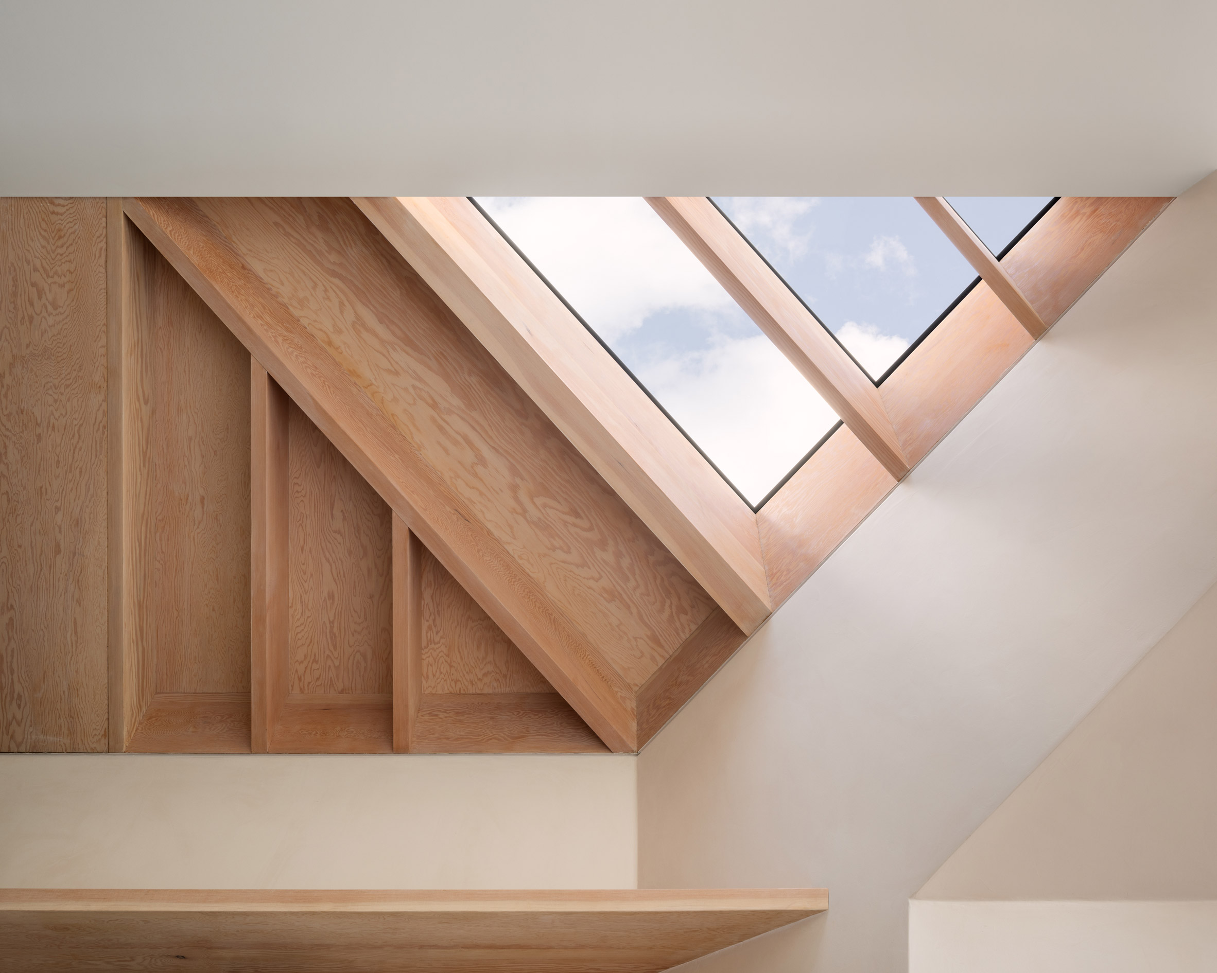 An exposed timber roof in a kitchen by Proctor & Shaw