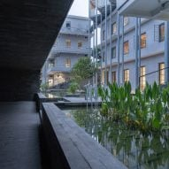 A walkway outside (Re)forming Duichuan Tea Yards centre by O-office Architects