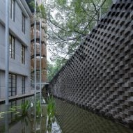 A pond outside the (Re)forming Duichuan Tea Yards centre by O-office Architects