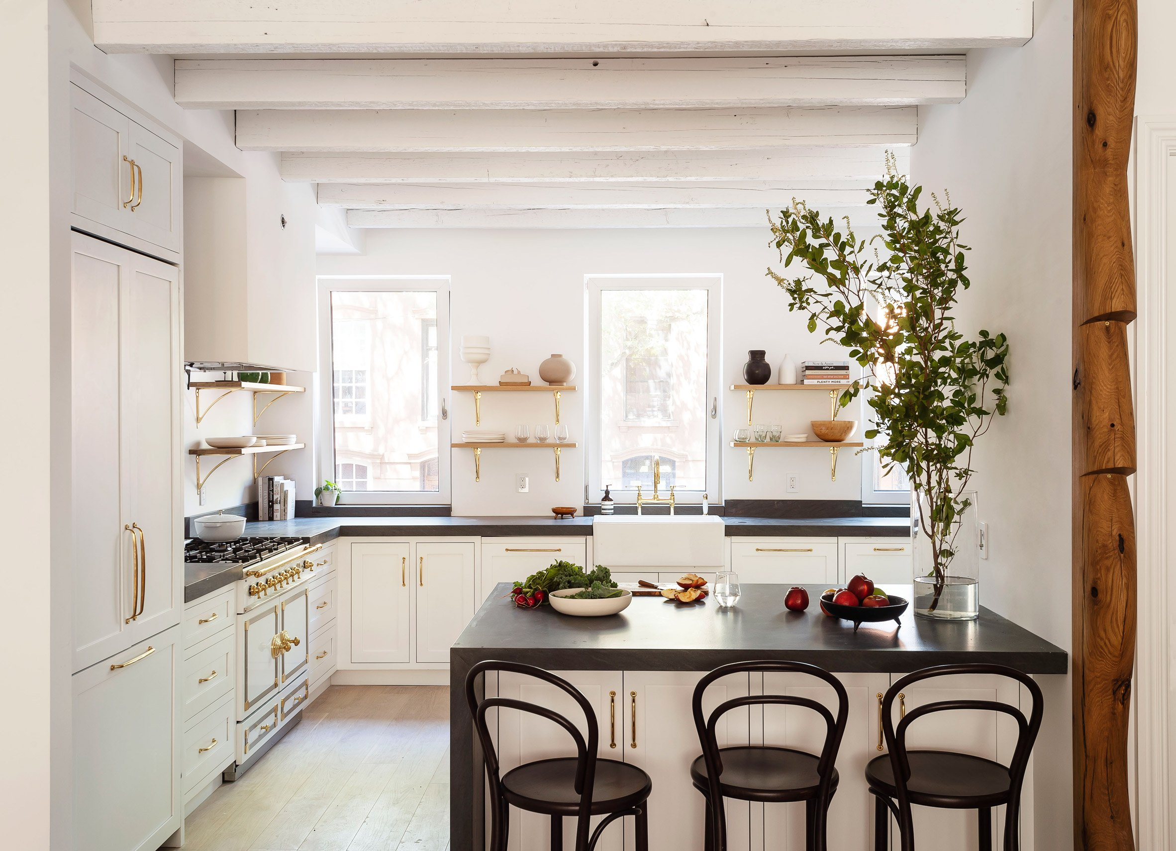 The Sackett Street townhouse's kitchen with exposed beams and hardware fixtures