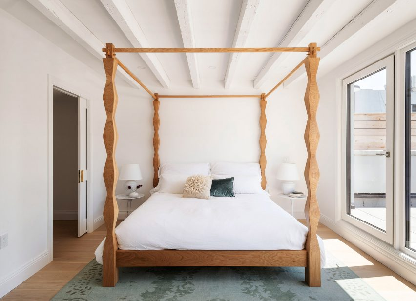 The Sackett Street townhouse's main bedroom's hand-crafted bed